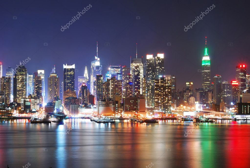 New York City Skyline with Times Square and Empire State Building at night.  Stock Photo #4025587
