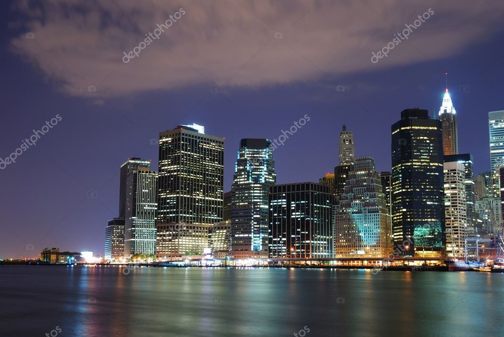New York City Manhattan skyline with office skyscrapers building in at dusk illuminated with lights at night over Hudson River — Foto de Stock   #4025950
