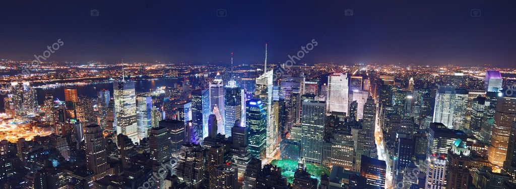 New York City Manhattan Times Square panorama aerial view at night with office building skyscrapers skyline illuminated by Hudson River. — Foto Stock #4026058