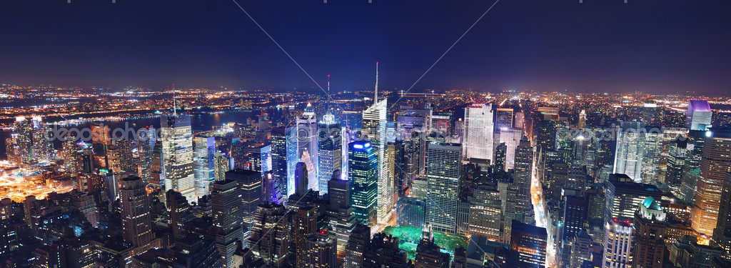New York City Manhattan Times Square panorama aerial view at night with office building skyscrapers skyline illuminated by Hudson River.  Stock Photo #4026058