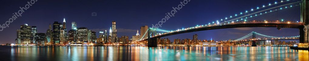 New York City Manhattan skyline panorama with Brooklyn Bridge and office skyscrapers building in at dusk illuminated with lights at night — Stockfoto #4026089