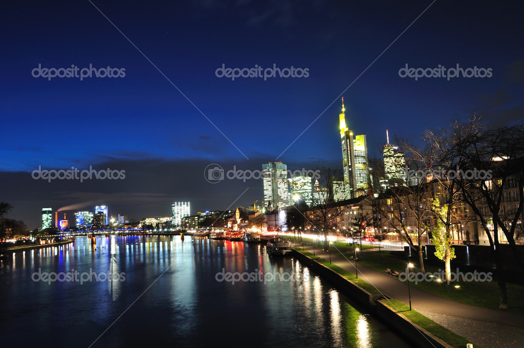 Skyscrapers and Main River at night in Frankfurt am Main, Germany  Stock Photo #4551494