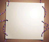 Color ropes and paper sheet frame — Stock Photo