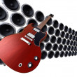 Stock Photo: Guitar in front of speakers