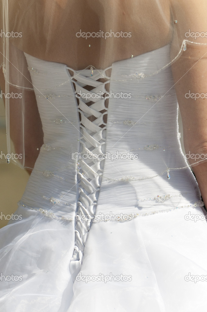 A close up of the back of a bride's dress showing the detail and lacing — Stock Photo #4018802
