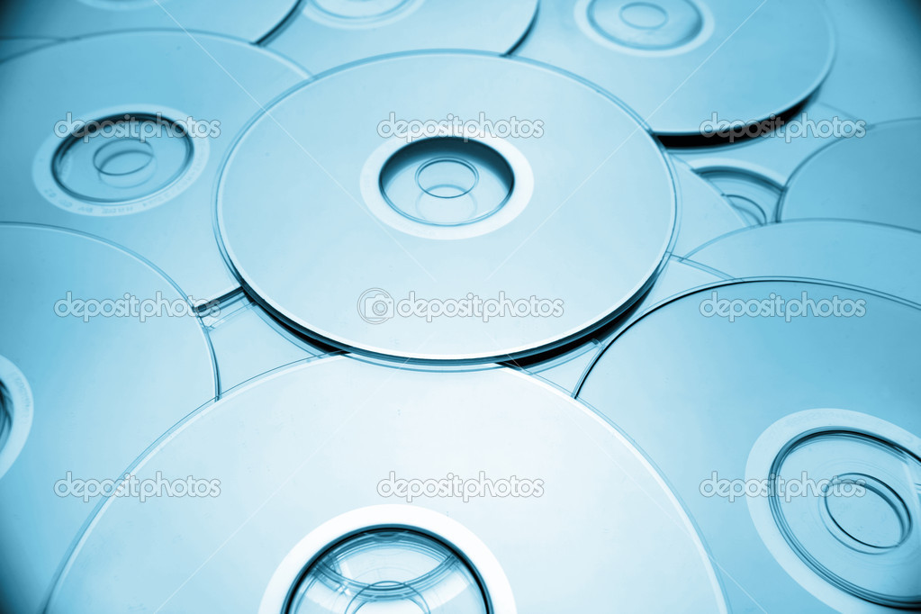 Closeup of compact discs. Blue tone   — Stock Photo #4316928