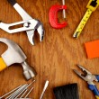 Stock Photo: Assorted work tools on wooden panel