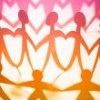 Crowd of colorful holding hands — Stock Photo