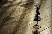 Silhouette of the Сhristmas tree on a wooden floor — Stock Photo