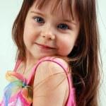 Pretty little girl in pink dress — Stock Photo