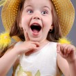 Stock Photo: Smiling little girl in a straw hat