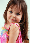 Pretty little girl in pink dress — Stock Photo
