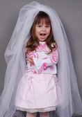 Pretty little girl in a white veil — Stock Photo