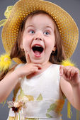 Smiling little girl in a straw hat — Stock Photo