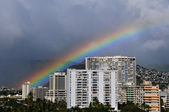 Hawaiian rainbow over the city — Stock Photo
