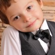 Stock Photo: Boy in suit and bow tie