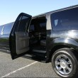 Black stretch limo with door open - Stock Photo