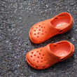 Orange croc style shoes — Stock Photo