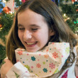 Christmas girl opening presents — Stock Photo