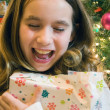 Stock Photo: Christmas girl opening presents