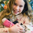 Christmas girl opening electronic presents — Stock Photo