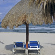 Two chairs and palapa on beach — Stock Photo