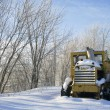 Stock Photo: Snow covered tractor with space