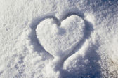 Heart shape in snow — Stockfoto