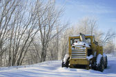 Snow covered tractor with space — Stock Photo