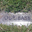 Grave marker of child — Stock Photo