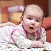 Cute baby-girl with her mouth open — Stock Photo