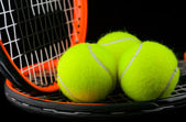 Three tennis-ball and two racket — Stock Photo