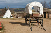 Wagon and wigwam — Stock Photo