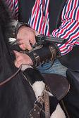 Revolver in cowboy arm — Stock Photo