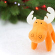 Toy elk in artificial snow — Stock Photo