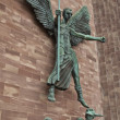 Stock Photo: Angel Gabriel banishes Lucifer at Coventry Cathedral in Coventry
