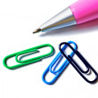Stock Photo: Three paper clips and pen.