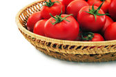 Ripe tomatoes in a basket. — Stock Photo