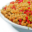 Stock Photo: Red and white currants in metal plate.