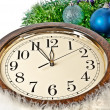 Hours and the bright New Year's ornaments. — Stock Photo