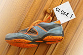 Sneakers hanging on the door handle. — Stock Photo