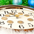 Stock Photo: Hours and bright New Year's ornaments.
