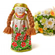 Stock Photo: Russitraditional doll in dress and bouquet of flowers.