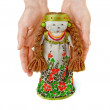 Royalty-Free Stock Photo: Woman\'s hands  gently keep  a Russian traditional doll.