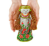 Woman's hands gently keep a Russian traditional doll. — Stock Photo