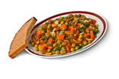 Vegetable salad in a plate and bread slice. — Stock Photo