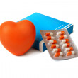 Orange heart and box with a medicine. — Stock Photo