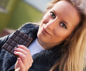 Girl with a chocolade — Stock Photo