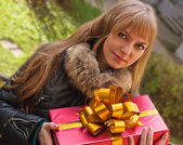 Young girl with a present — Stock Photo