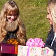 Young smiling girls with presents — Stock Photo